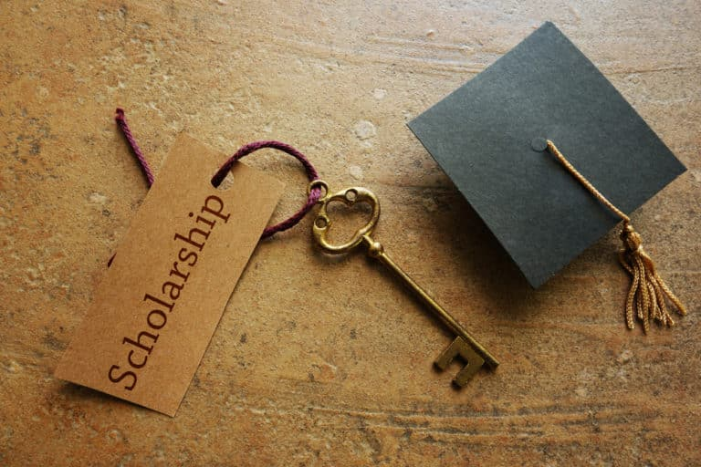 Gold key with Scholarship tag,