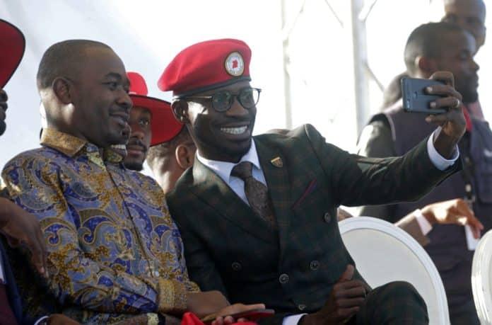 Ugandan opposition politician Bobi Wine takes a selfie with Zimbabwe's opposition leader Nelson Chamisa Aaron Ufumeli/EPA-EFE